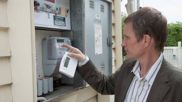 Richard Keech with his smart meter at his Essendon home in Melbourne.