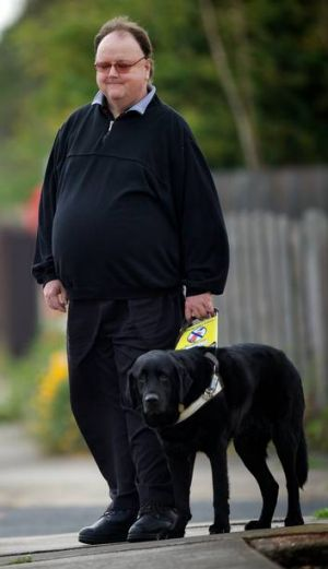Murray Rowland with his guide dog, Zarr.