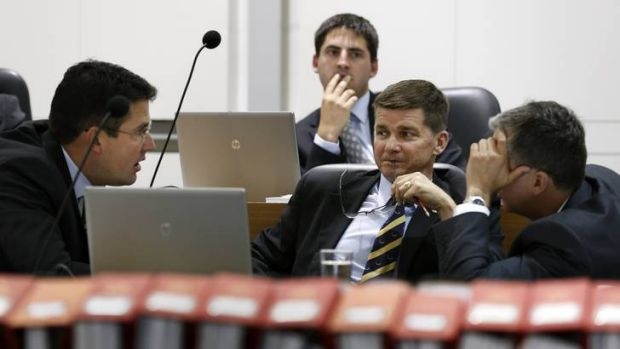 Opposition leader Zed Seselja chats with Brendan Smyth and Jeremy Hanson during Question Time on Tuesday.