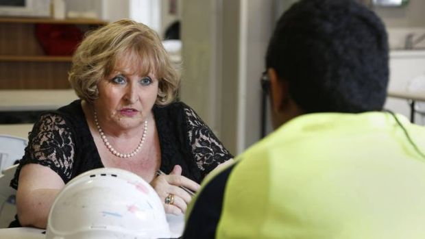 Psychologist Carmel O'Sullivan speaks with a worker on an ACT work site, she has worked with workers and their families ...