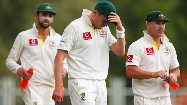 Hopes dashed: Nathan Lyon, Peter Siddle and David Warner at the end of the Adelaide Test.