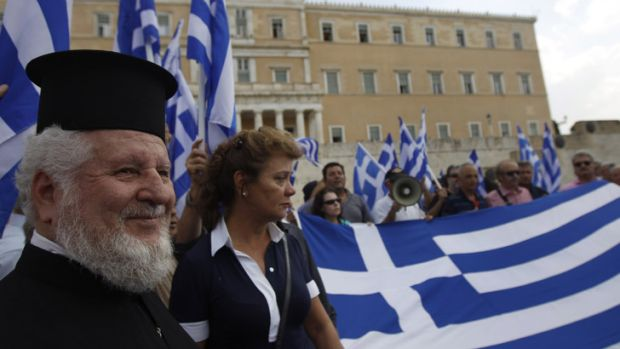 Austerity protest: Greece has reached agreement with eurozone partners on debt repayments, but austerity measures will ...