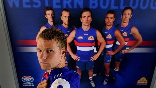 Proud Bulldog: Jake Stringer with the No. 9 guernsey he will wear for the Western Bulldogs.