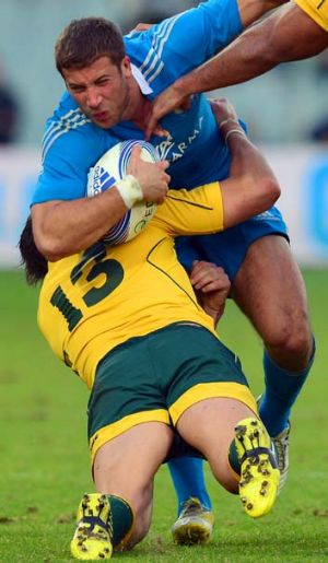 Get stuck in … Adam-Ashley Cooper tackles Tommaso Benvenuti in Saturday's match against Italy in Florence.