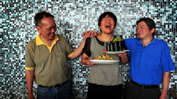 Portia Yeung (centre) is now manager of Wok and Roll in Fyshwick, pictured with her chefs Chi Ying Chan (left) and Wai ...