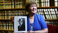 Betty Sheelah with a portrait of her father's first cousin, Fred