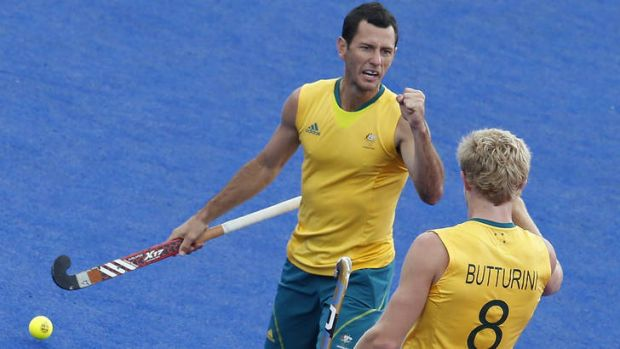 In the twilight: Jamie Dwyer celebrates an Olympic goal with teammate Matthew Butturini.
