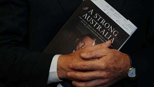 No such thing as a free launch ... Tony Abbott with his new book, A Strong Australia.