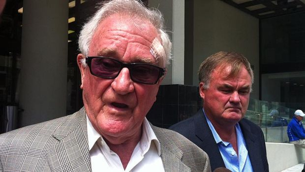 Wilson and Michael Tuckey outside court on Thursday,