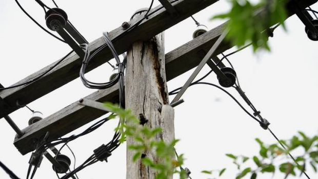 Andrew Moseley of Lyons has concerns about the rotting power pole that is located at the rear of his property.