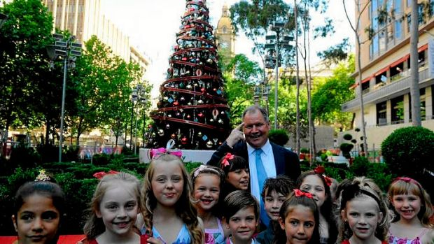 Lord Mayor Robert Doyle with kids from the May Downs dancing school in front of the Christmas tree in the city square.