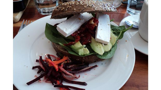 The health bagel - topped with greens, avocado, feta and sundried tomatoes with a side salad of julienne carrot and beetroot