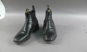 Former prime minister Kevin Rudd's boots are on display at the Museum of Australian Democracy.