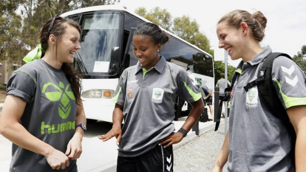 Canberra United recruit Nikki Washington, centre, chats with teammates Hayley Raso, left, and Nicole Sykes, right.