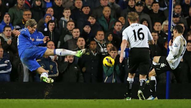 Volley good show ... Chelsea's Fernando Torres takes a shot against Fulham during the scoreless draw at Stamford Bridge ...