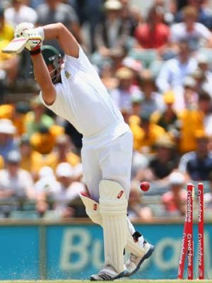Starc gets through Jacques Kallis' defence.