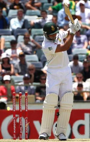 South Africa opener Alviro Petersen is bowled by Mitchell Starc.