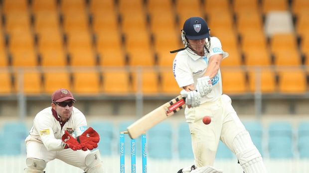 Sean Abbott bats during day four of the Sheffield Shield match against Queensland at Manuka Oval.