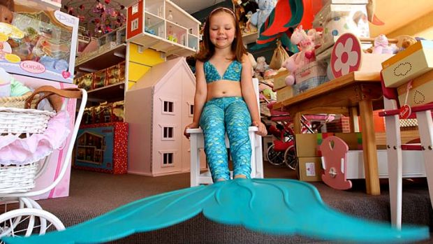 If the fin fits… Kira Delaney tries on a Merfin at Hopscotch Toys in Mosman.