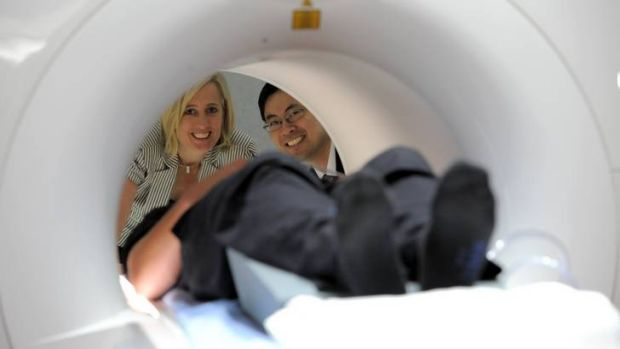ACT Health Minister Katy Gallagher is given a demonstration of the new MRI equipment by Dr Raymond Kuan, Chairman of the ...