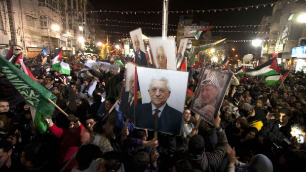 A country born: Palestinians celebrate the historic vote to become a non-member observer state at the UN.