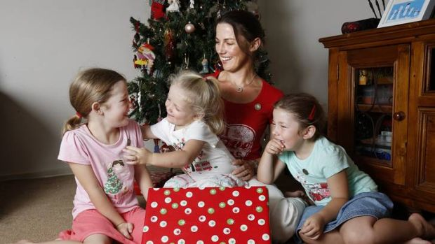 Samantha Murray with daughters Emily, 6, left, Zara, 2, and Lauren 4, at their Gungahlin home.