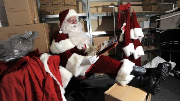 Part-time Santa at Westfield Belconnen, John Rundle, relaxes between shifts in a back room.