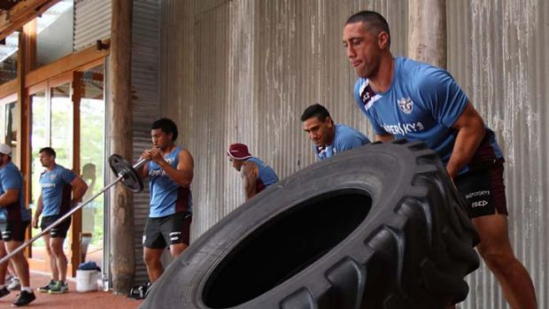 No pain, no game ... veteran prop Brent Kite, with tractor tyre, shows his younger Manly teammates the way at a training ...
