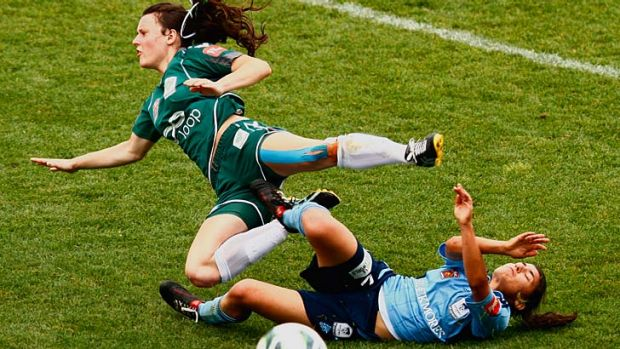 Crunch clash … Hayley Raso is tackled by Teresa Polias in Sydney FC's match on Saturday.