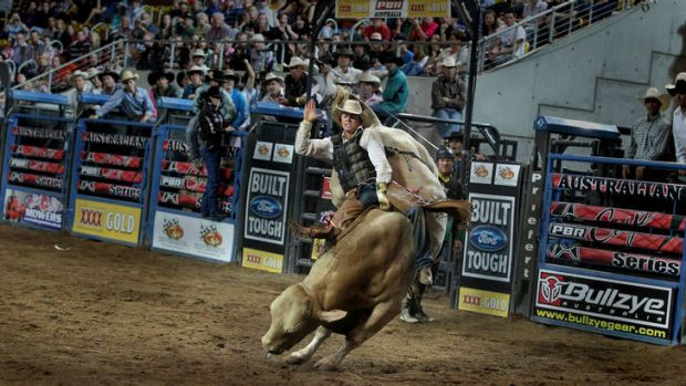 John Crasti bull riding at a rodeo in Tamworth.