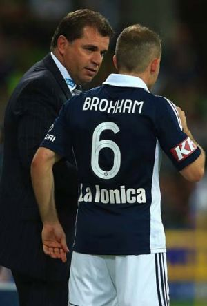 Ange Postecoglou talks to Leigh Broxham during the round nine A-League match against Perth Glory.