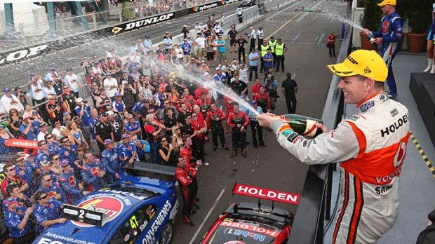 Exalted: Craig Lowndes celebrates his win on Saturday.