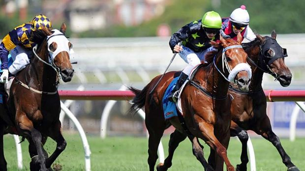 Jake Duffy rides Shout Out Loud to victory in the The 65 Roses Victoria Cup at Caulfield.