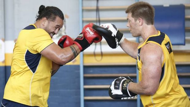 Brumbies players Fotu Auelua and Clyde Rathbone boxing during training.