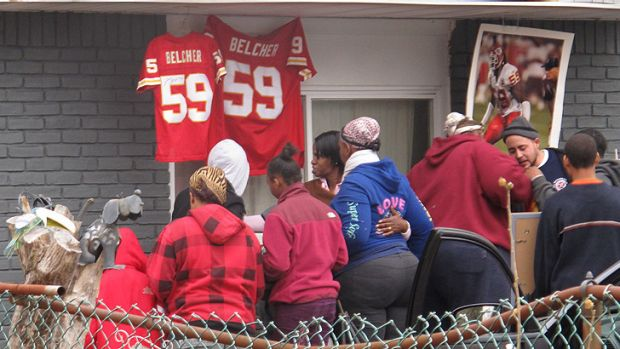 Friends and relatives of Jovan Belcher grieve outside his home in West Babylon, New York.