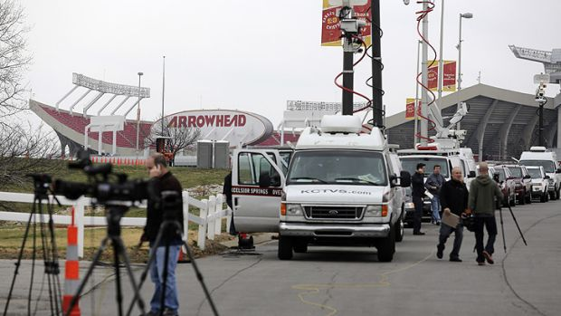 Members of the media gather near Arrowhead Stadium in Kansas City as they report on the death of Jovan Belcher, who ...
