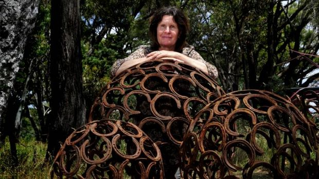 Melinda Knowles of Mittagong with her horse shoe garden art at the Hall Markets.