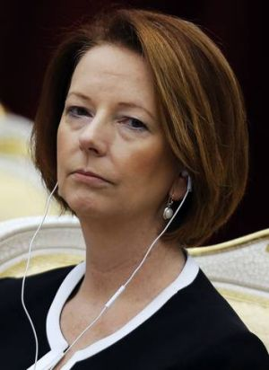 Julia Gillard, pictured at the ASEAN summit in Phnom Penh last month,  is now more relaxed with her part in foreign policy.