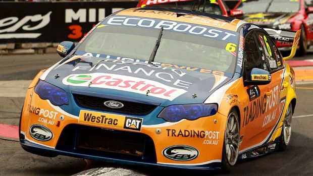 Airborne … Ford's Will Davison gets his car on two wheels during the final race of the V8 Supercars series on the ...