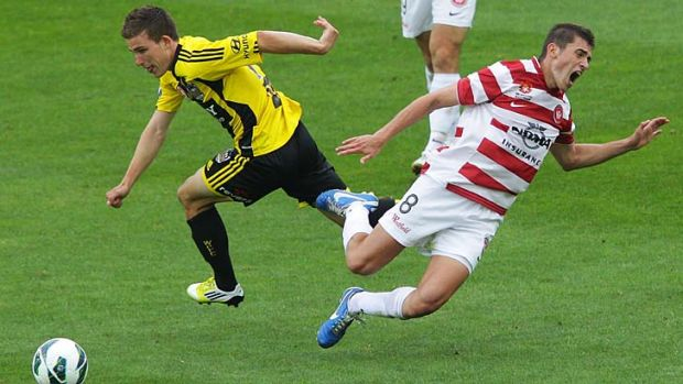 Collision … Louis Fenton of Wellington Phoenix and Western Sydney's Mateo Poljak get in a tangle. Wellington ...