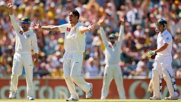 Mitchell Johnson successfully appeals for leg before to dismiss Dean Elgar.