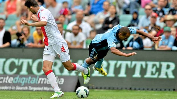 All ends up: Fabio Alves takes to the air for Sydney FC.