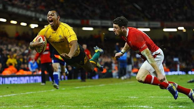 Flying Wallaby: Australia's Kurtley Beale launches himself over the try line to break Welsh hearts.