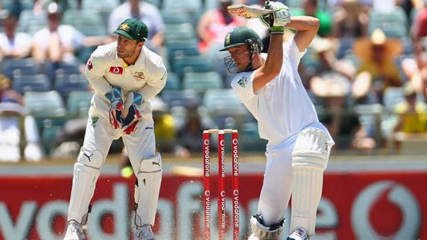 Happy hunting ground ... A.B. de Villiers sends another delivery hurtling towards the boundary during his dashing knock ...