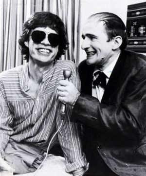 Norman Gunston (Garry McDonald) with Mick Jagger.