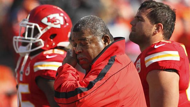 Kansas City Chiefs coach Romeo Crennel wipes his eyes before Sunday's match against the Panthers.