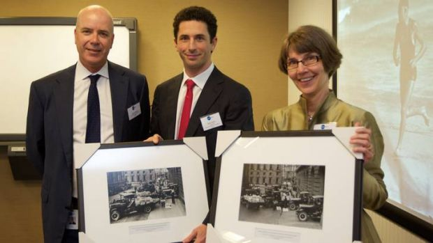 Fairfax CEO Greg Hywood (left) presents framed photographs to Ryan Stokes, Chairman of the National Library of Australia ...