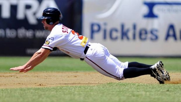 Cavalry star Ryan Stovall slides for third base.