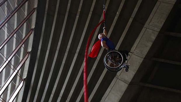Steel will ... Paul Nunnari scales a ribbon suspended from the ceiling of the Sydney Opera House's southern foyer for ...