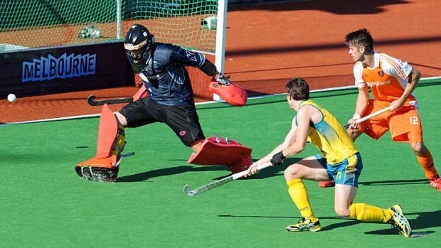Australia's goalkeeper George Bazeley deflects a shot at goal from a Netherlands penalty corner on Sunday.